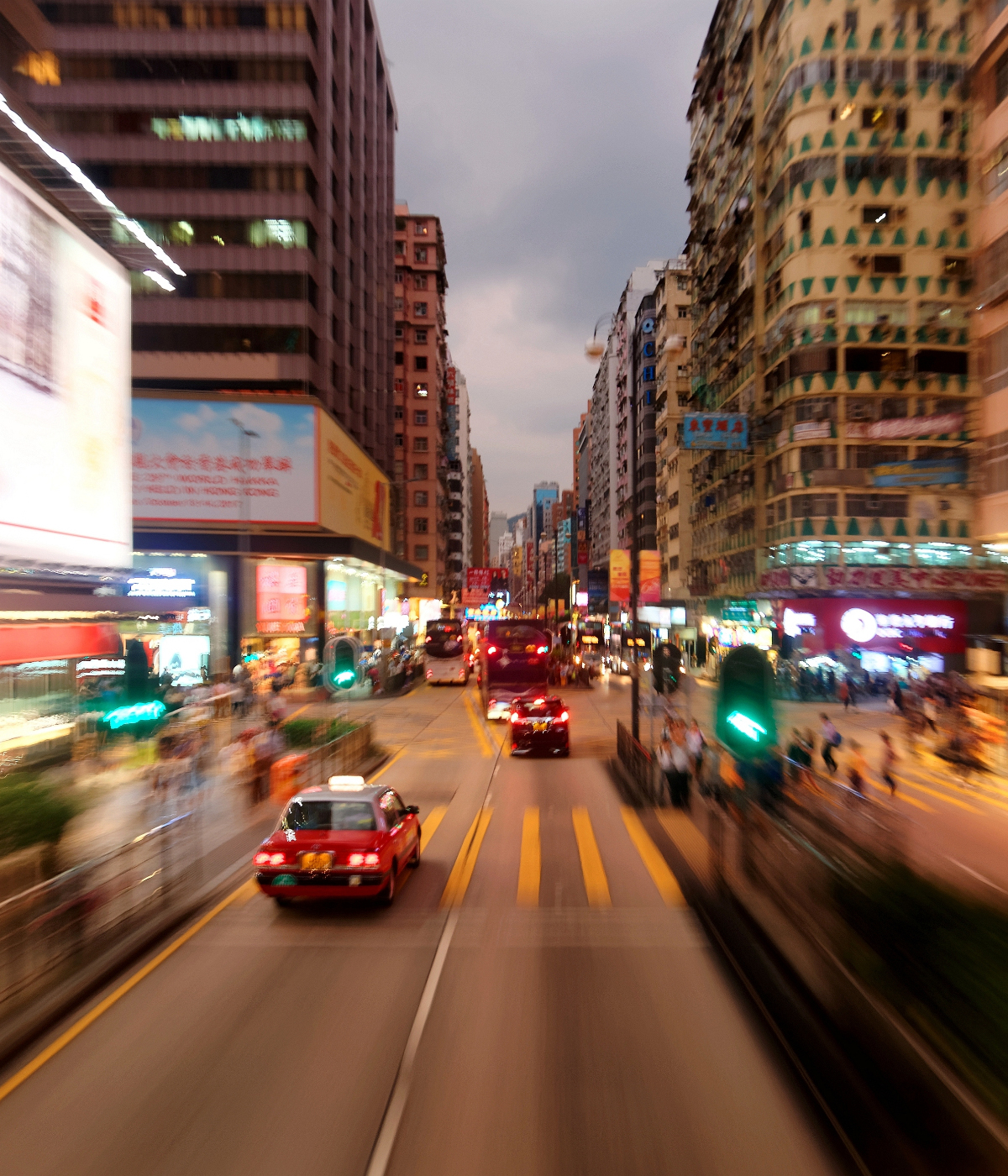 Cars driving on a road in Hong Kong.