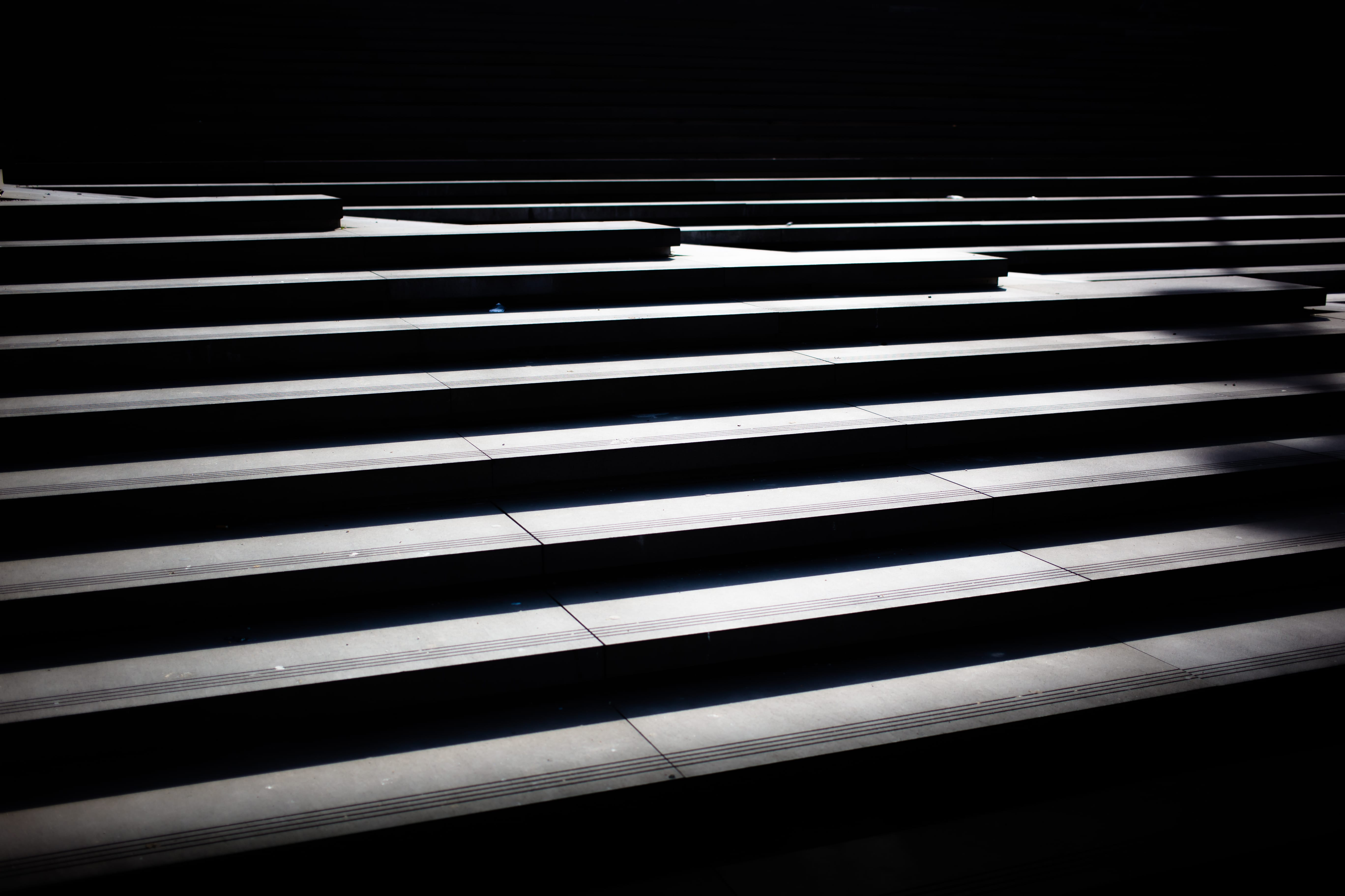 A flight of stairs shrouded in shadow